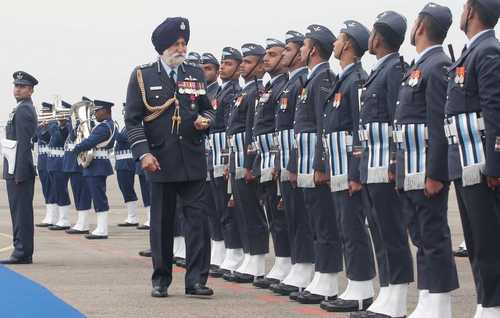 Jammu January 20 Marshal of the Indian Air Force (IAF) Arjan Singh being presented a guard of honour at Jammu and Kashmir technical airport in Jammu on Thursday.  Photo by Vishal Dutta